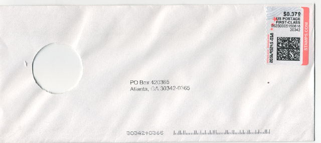 Envelope with a hole